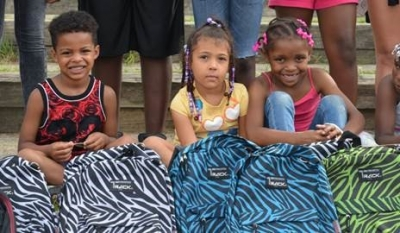 Nearly 750 Backpacks Assembled and Delivered to Children in Need