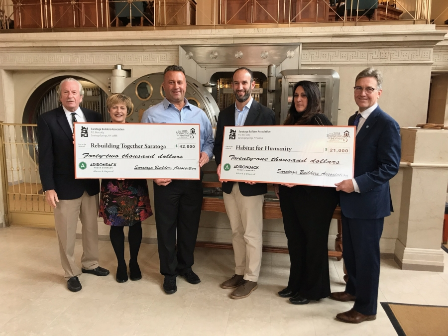 The Saratoga Builders Association is proud to present a total of $63,000 to our two local charities from the proceeds of the 2018 Saratoga Showcase of Homes. From left to right: Barry Potoker, Executive Director- Saratoga Builders Association and Showcase Co-Chair, Michelle Larkin, Executive Director -Rebuilding Together Saratoga County, Dave Trojanski, President of Saratoga Builders Association, Adam Feldman, Executive Director – Habitat for Humanity of Northern Saratoga, Warren and Washington Counties, Lisa Licata, Showcase Co-Chair, Stephan von Schenk, President and CEO-Adirondack Trust Company.